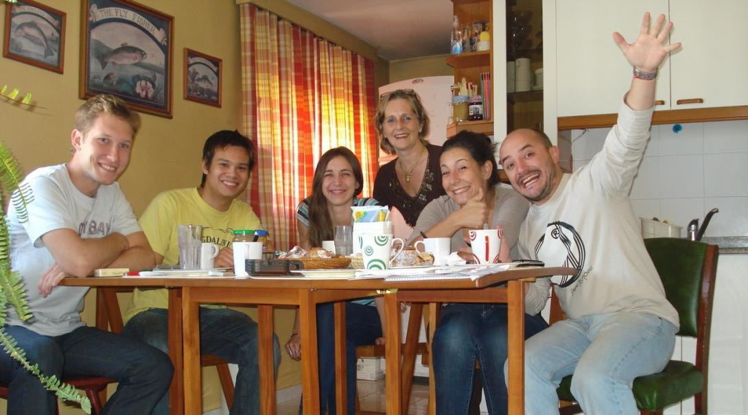 Volunteers have tea and cake with their host family in Cordoba